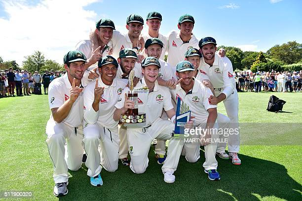 Australian captain Steve Smith holds the Trans Tasman trophy with his team after winning the 2nd Test during day five of the second cricket Test...