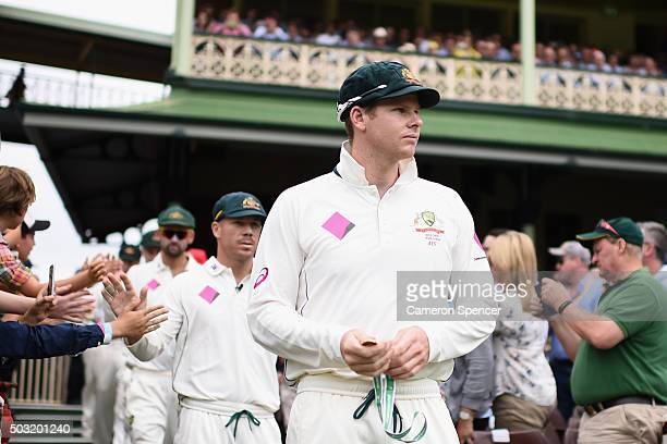 Australian captain Steve Smith leads his team onto the field during day one of the third Test match between Australia and the West Indies at Sydney...