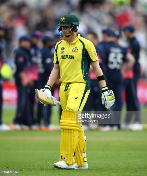 Australian captain Steve Smith leaves the field after being dismissed by Mark Wood of England during the ICC Champions Trophy match between England...