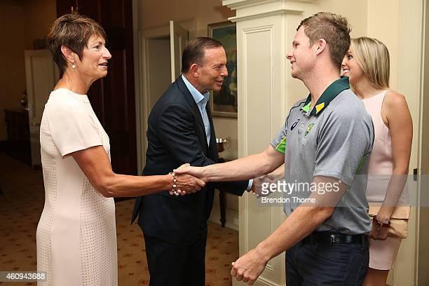 Australian captain Steve Smith meets Australian Prime Minister Tony Abbott during the Australian and Indian cricket team visit at Kirribilli House on...