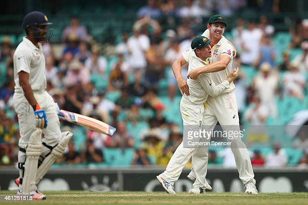 Australian captain Steve Smith of Australia celebrates with Josh Hazlewood of Australia after catching out Rohit Sharma of India off a delivery by...