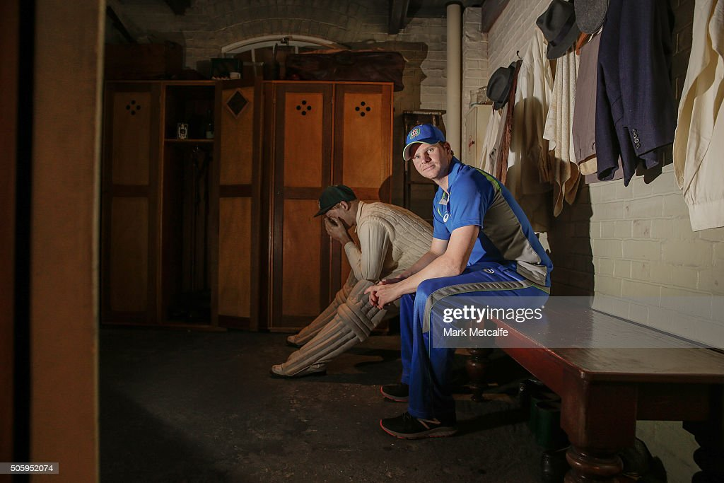 Australian captain Steve Smith poses next to a model of Sir Donald Bradman during an Australian cricket squad visit to the Bradman Museum on January 21, 2016 in Bowral, Australia.