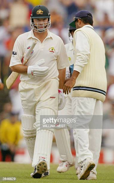 Australian captain Steve Waugh walks straight past Indian captain Sourav Ganguly after been dismissed in his final innings before retiring on the...