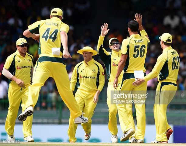 Australian captain Steven Smith and cricketer Mitchell Starc celebrate with his teammates the wicket of Sri Lanka cricketer Kusal Perera during the...