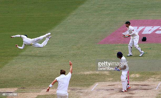 Australian captain Steven Smith dives to catch out Rohit Sharma of India during day five of the Fourth Test match between Australia and India at...