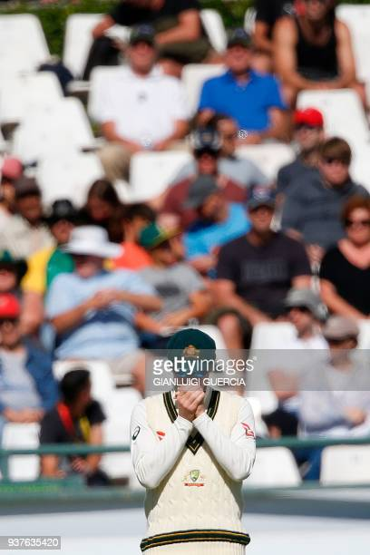 Australian Captain Steven Smith stands by stumps during the fourth day of the third Test cricket match between South Africa and Australia at Newlands...
