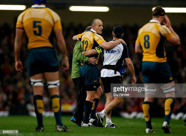 Australian captain Stirling Mortlock is taken off injured during the Invesco Perpetual Series match between Wales and Australia at the Millennium...