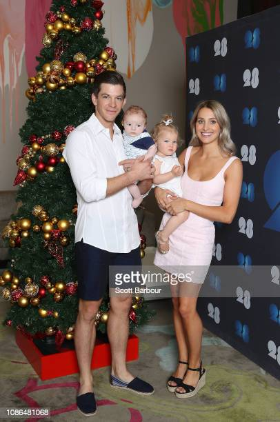 Australian captain Tim Paine along with his children Milla and Charlie and his wife Bonnie Maggs pose next to a Christmas tree during an Australian...