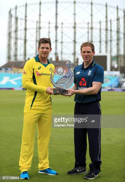 Australian Captain Tim Paine and England Captain Eoin Morgan stand with the trophy during an England Australia Net Session at The Kia Oval on June 12...
