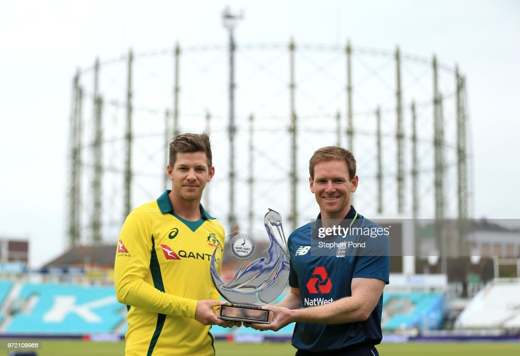 Australian Captain Tim Paine and England Captain Eoin Morgan stand with the trophy during an England & Australia Net Session at The Kia Oval on June 12, 2018 in London, England.