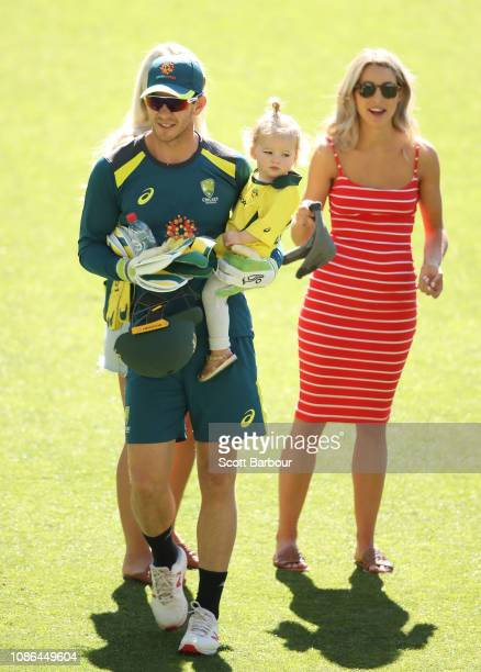 Australian captain Tim Paine holds his daughter Milla as his wife Bonnie Maggs looks on during an Australian training session at Melbourne Cricket...