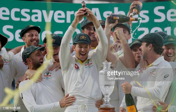 Australian captain Tim Paine lifts the Ashes urn at the presentation ceremony after the match during day four of the England v Australia 5th Ashes...