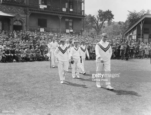 Australian captain Warwick Armstrong leads his team out for a Test match against England at Trent Bridge Nottingham May 1921