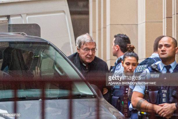 Australian Cardinal George Pell is escorted into the Supreme Court of Victoria in Melbourne on June 6 2019 Pell asked appeals court judges to quash...