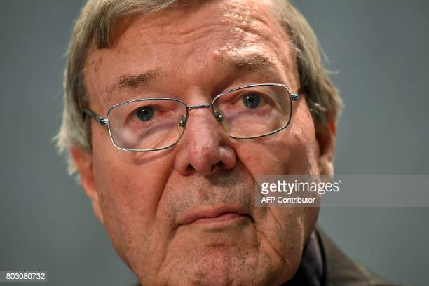 Australian Cardinal George Pell looks on as he makes a statement at the Holy See Press Office Vatican city on June 29 2017 after being charged with...