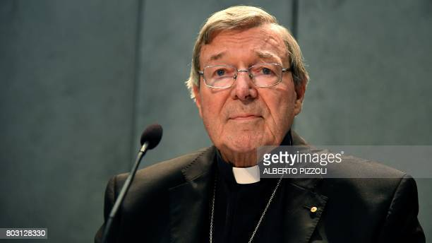CORRECTION Australian Cardinal George Pell looks on as he makes a statement at the Holy See Press Office Vatican city on June 29 2017 after being...