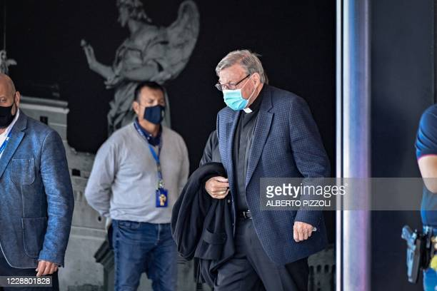 Australian Cardinal George Pell prepares to get into a car after landing at Rome's Fiumicino airport on September 30 returning for the first time...
