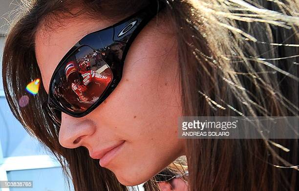 Australian Casey Stoner of the Ducati team is reflected in his wife's sunglasses on September 4, 2010 at the end of a qualifying session for the...
