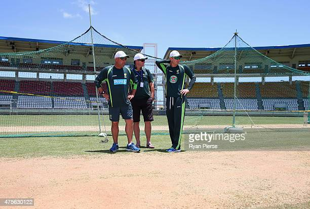 Australian coach Darren Lehmann Australian Selector Mark Waugh and Michael Clarke of Australia inspect the pitch during an Australian nets session at...