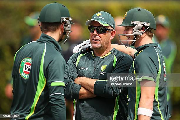 Australian coach Darren Lehmann shares a joke with his players Michael Clarke and Steven Smith during an Australian training session at Sydney...