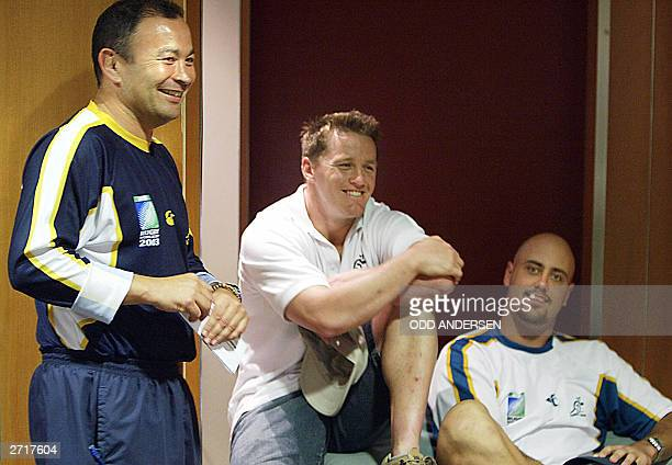 Australian coach Eddie Jones shares a light moment with flyhalf Elton Flatley and lock Nathan Sharpe before a press conference in Coffs Harbour 11...