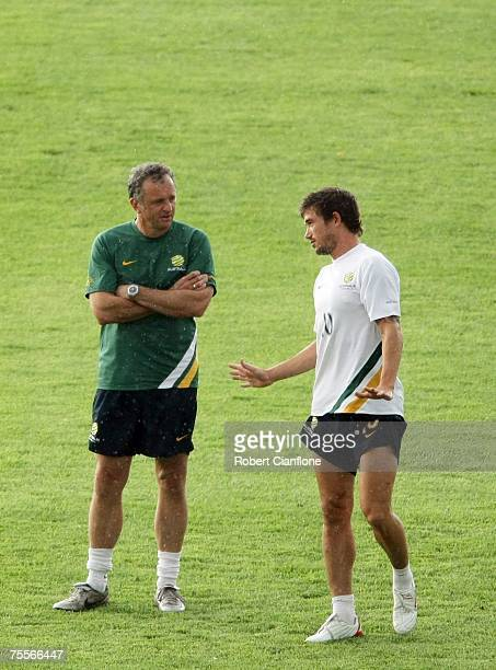 Australian coach Graham Arnold talks with Harry Kewell during an Australian Socceroos training session at the Mi Dinh National Stadium on July 20...