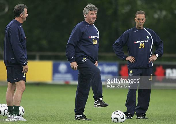 Australian coach Guus Hiddink looks on with his assistants Graham Arnold and Johan Neeskens during a training session as Australia prepare for the...