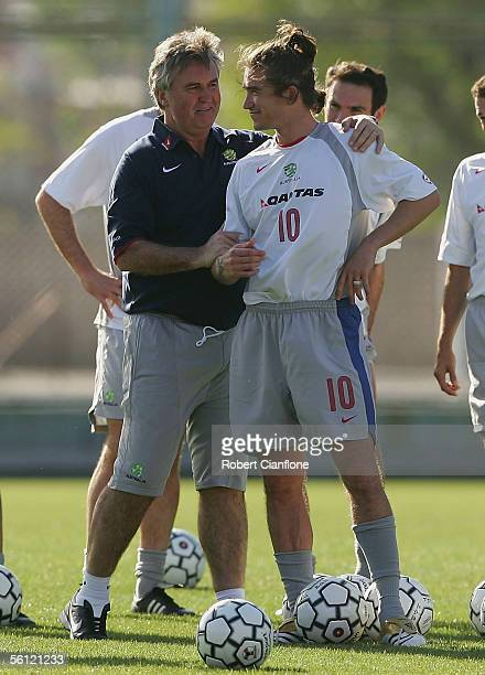 Australian coach Guus Hiddink talks to Harry Kewell during a training session at the San Lorenzo Stadium, as part of preparations for the World Cup...