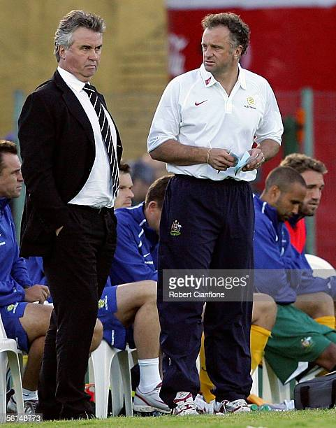 Australian coach Guus Hiddink talks with assistant Graham Arnold during the first leg of the FIFA 2006 World Cup Playoff between Uruguay and...