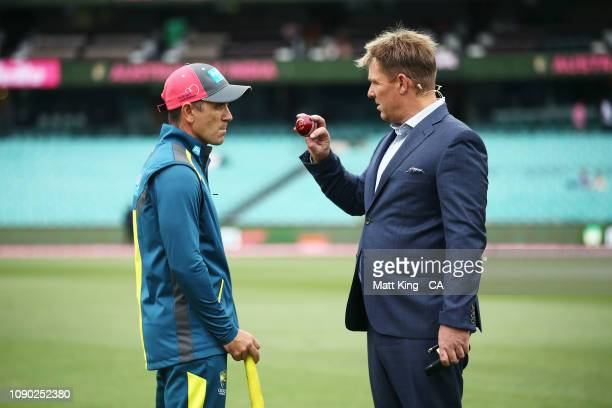 Australian coach Justin Langer talks to former Australian cricketer and commentator Shane Warne during day four of the Fourth Test match in the...