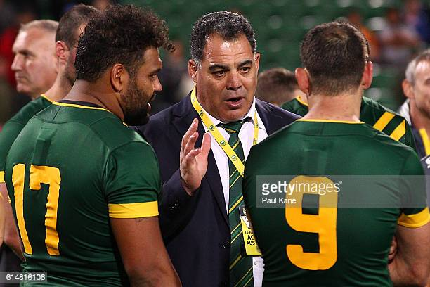 Australian coach Mal Meninga talks with Sam Thaiday and Cameron Smith after winning the International Rugby League Test match between the Australian...