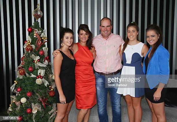 Australian coach Mickey Arthur poses with his family Brooke wife Yvette Ashton and Kristin next to a Christmas tree ahead of a Cricket Australia...