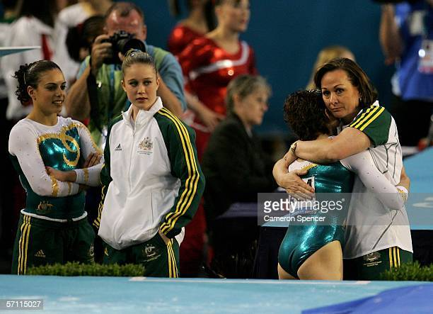 Australian coach Peggy Liddick embraces Chloe Sims of Australia after her Floor routine during the Womens Team competition in the Artistic Gymnastics...