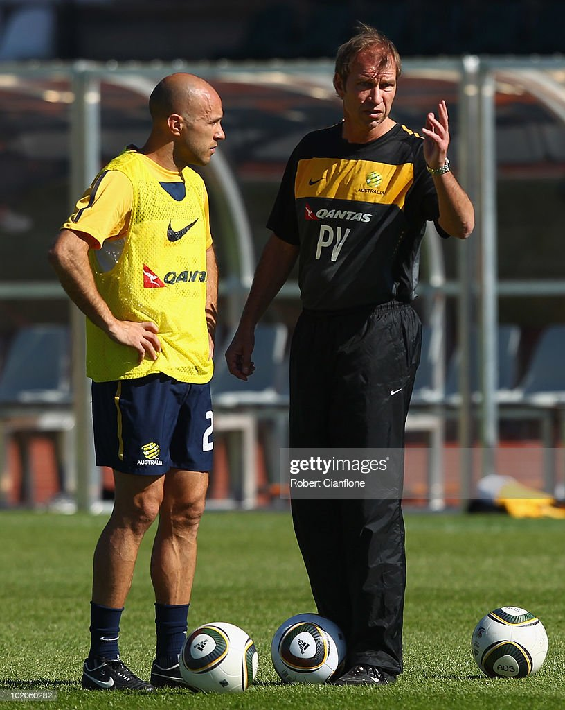 Australian coach Pim Verbeek talks to Mark Bresciano (L) of Australia looks on during an Australian Socceroos trainin session at Ruimsig Stadium on June 14, 2010 in Roodepoort, South Africa.