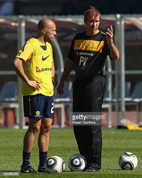 Australian coach Pim Verbeek talks to Mark Bresciano of Australia looks on during an Australian Socceroos trainin session at Ruimsig Stadium on June...
