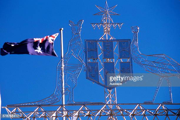 Australian coat of arms on Parliament House and flag Canberra Australian Capital Territory Australia