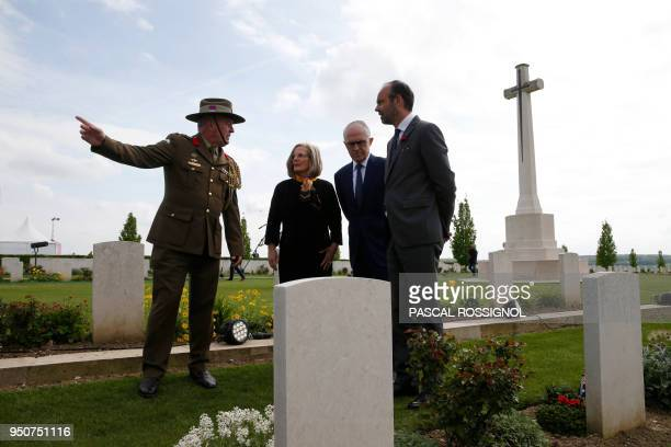 Australian Colonel Scott Clingan escorts French Prime Minister Edouard Philippe and Australian Prime Minister Malcolm Turnbull and his wife Lucy...