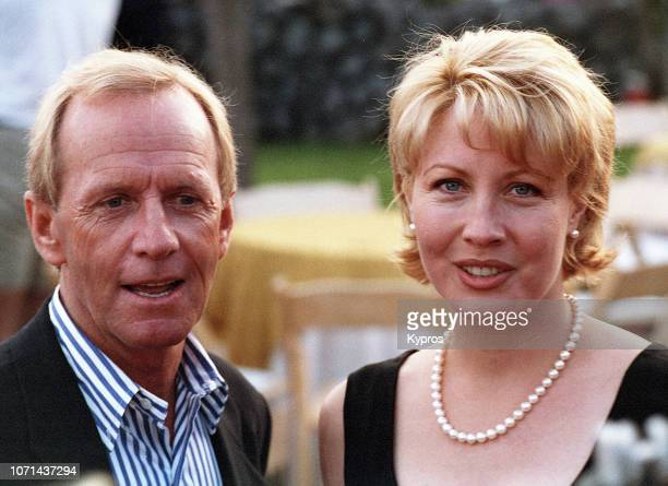 Australian comedian actor and television presenter Paul Hogan and his wife American actress Linda Kozlowski attend a red carpet event circa 1990