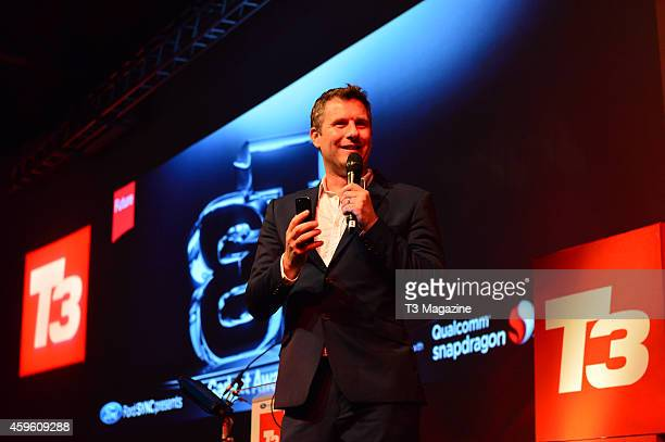 Australian comedian Adam Hills on stage at the 2013 T3 Gadget Awards inside the Old Billingsgate Market in London on October 3 2013