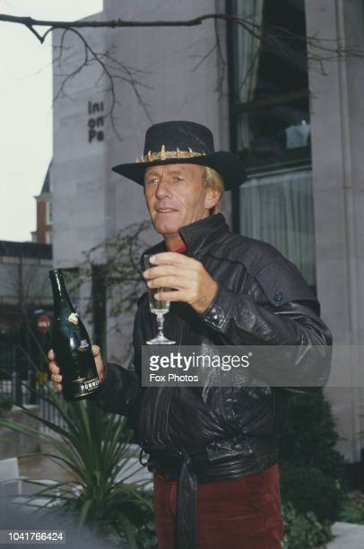 Australian comedian and actor Paul Hogan star of the film 'Crocodile Dundee' drinking champagne at the Inn on the Park London January 1987