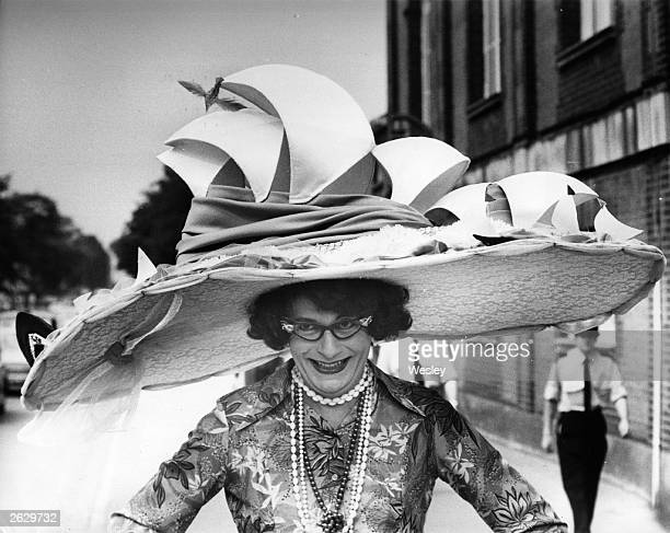 Australian comedian Barry Humphries dressed as his most famous character Dame Edna Everage modelling a stunning Ascot hat based on the Sydney Opera...