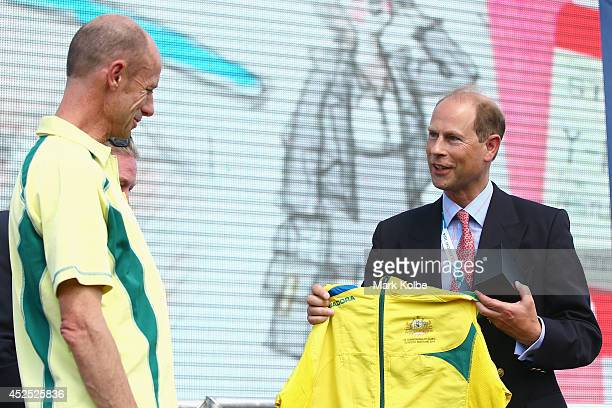 Australian Commonwealth Games chef de mission Steve Moneghetti presents Prince Edward Earl of Wessex and Australia tracksuit during the Australian...