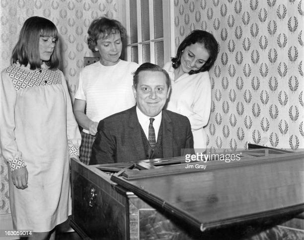 Australian conductor Charles Mackerras playing a keyboard instrument backstage at the Sadler's Wells Theatre, London, November 1965.