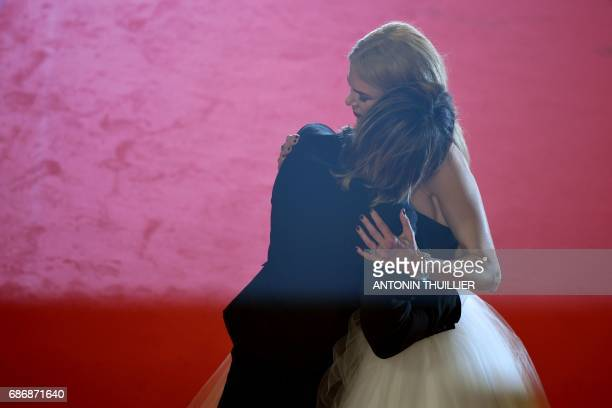 Australian country singer Keith Urban kisses his wife Australian actress Nicole Kidman as they leave the Festival Palace on May 22 2017 following the...