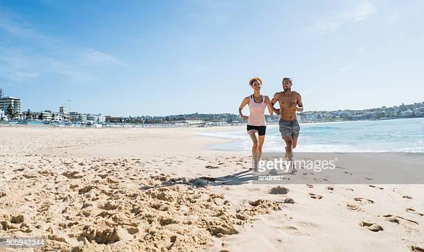Australian couple running at the beach