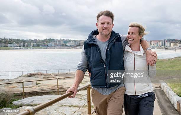 Australian couple walking by the beach