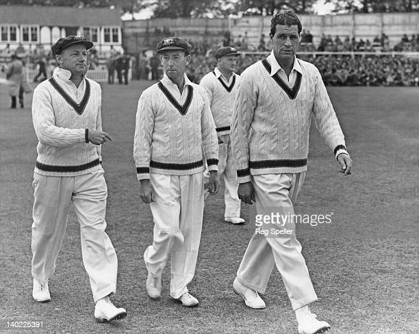 Australian cricket captain Don Bradman leads his team out to field during a threeday match against Worcester County Cricket Club at New Road...