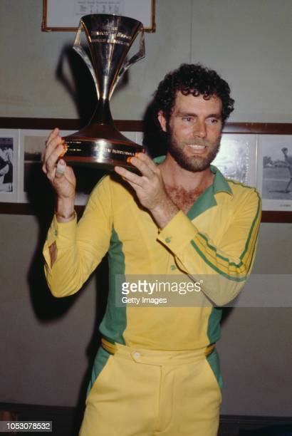 Australian cricket captain Greg Chappell holding the Benson Hedges World Series Cup after Australia beat New Zealand to win the series at Sydney...