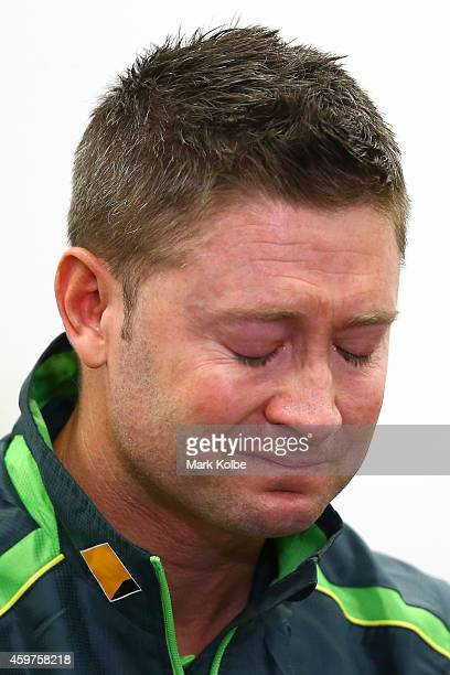 Australian cricket captain Michael Clarke pauses as he reads a statement on behalf of the Australian cricket team in response to the death of...