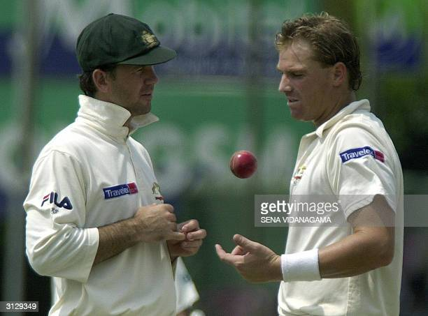 Australian cricket captain Ricky Ponting talks with bowler Shane Warne during the seond day of the final Test match between Sri Lanka and Australia...